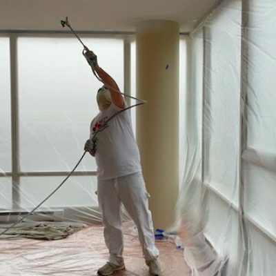 maple brothers painting & renovation painter working